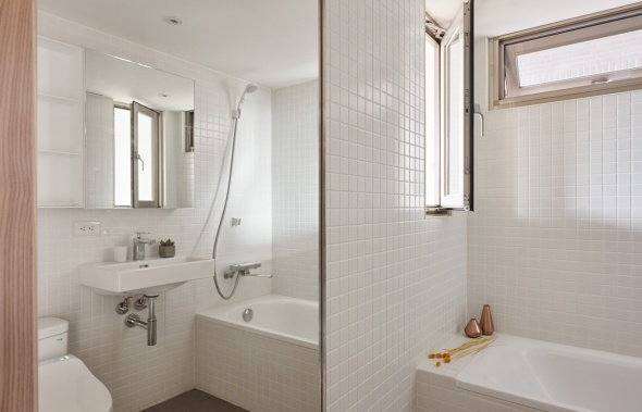 bright-white-tiled-bathroom
